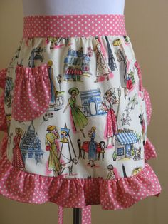 """She makes adorable vintage-looking aprons.... """"Pink Half Apron with Springtime in Paris print by ApronsbyJosie"""""""