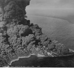 """Burning off the coast of Virginia is the American tanker """"Dixie Arrow"""" torpedoed by German submarine U-71. The ship was hit by two torpedoes and sunk two hours later with the loss of 11 crew members. 22 survivors were rescued by USS Tarbell (DD 142) an escort destroyer."""