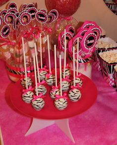 Awesome animal print cake pops!  See more party planning ideas at CatchMyParty.com!