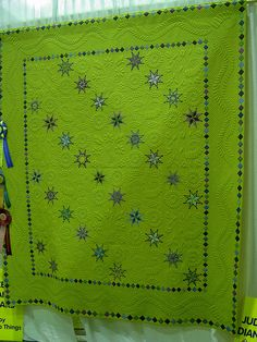 Starlicious pieced & quilted by Sandi McMillan.  It must be this shade of green.  I don't normally like green and this is the second green quilt that I just think is gorgous.