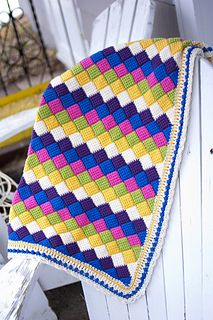 The Playing Blocks Baby Blanket is an addictive crocheted entrelac blanket made with soft and bright Longmeadow and with a wide lace border to make it extra special. Be sure to check out the coordinating knitted Huggable Toys.