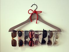 Use a Hanger Attached to Wall with Command Hook For Storing Sunglasses : keeps them from getting lost or scratched from being shoved in a drawer!