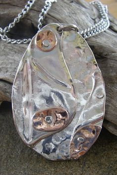 Silver overlay on hammered spoon bowl with copper detail Pendant...for sale at Health Haven, Deep River...SOLD