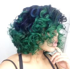 Short curly hair. Navy blue roots blending to forest green.