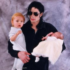 Michael Jackson with Prince as a toddler and Paris as a baby.