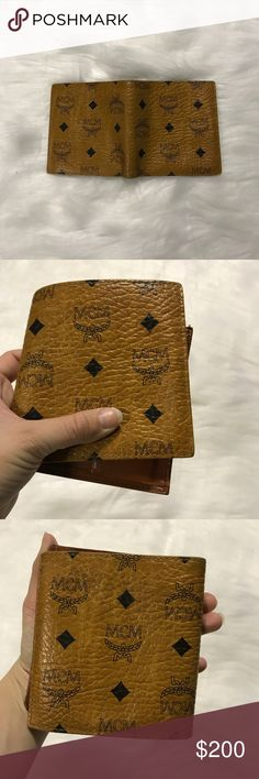 MCM Vintage Trifold Wallet Beautiful vintage MCM trifold wallet. This amazing piece is lived in, but has kept up with the MCM name. The smooth leather with the classic brown and tan design is a timeless wallet to add to your collection. MCM Bags Wallets
