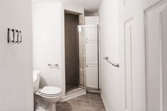 White Bathroom With Walk In Enclosed Shower