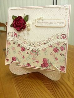 Used another Spellbinder border die.  Added a flower and pearls.  Distressed edges and adhered to the roses paper.