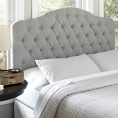 Blanchard Upholstered Headboard | Upholstered in elegant fabric, the Blanchard Headboard combines soft, sweeping curves with straight lines for timeless style. The beautiful, button-tufted upholstery is partnered with a sturdy, solid wood frame for long-lasting quality.