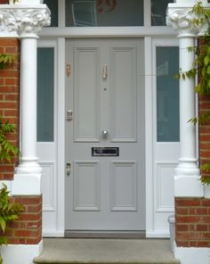 A pretty Victorian door design with period mouldings, delicate polished chrome door furniture and a hand-painted matte finish in a soft shade. Cottage Front Doors, Victorian Front Doors, Wood Front Doors, Front Door Entrance, House Front Door, Painted Front Doors, Entry Doors, Victorian Hallway, 4 Panel Doors