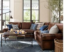 Iron and glass table to lighten room- love the leather sofa for family room- Room Decorating Ideas, Room Décor Ideas & Room Gallery | Pottery Barn