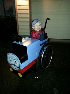 My handsome little 4 year old as the train conductor of Thomas the Tank Engine, Halloween night.  My husband and I made the whole thing custom to fit over his wheelchair.  I'm such a proud mama! <3