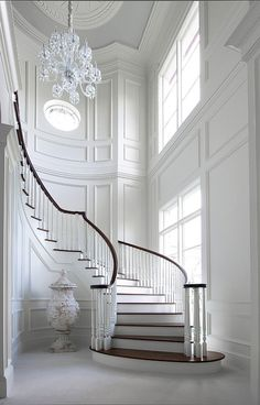 Chandelier, moulding and a staircase. The perfect guide for a grand space #martiinteriordesign