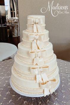 Ivory cascading fondant bows wedding cake