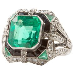 AGL 6.11 Colombian Emerald Diamond Onyx Platinum Ring | From a unique collection of vintage more rings at https://www.1stdibs.com/jewelry/rings/more-rings/
