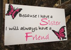 """This sweet sign has been specially created for sisters! Put in a shared bedroom, a nursery, or give to your own sister! Pink and Black lettering are scripted across a clean, white background. 2 butterflies and jewels complete the piece. Approximately 18"""" x 10"""""""