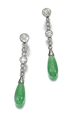 Jadeite and diamond earrings, circa 1915.  Each suspending a polished jadeite drop, to an articulated line millegrain-set with circular- and rose-cut diamonds, screw back fittings.
