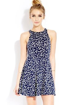 Style Deals - A skater dress featuring an allover contrast floral print. Round neckline. Sleevele...