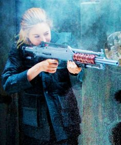 Look at Tris shooting! I CAN do that! Out of all the things that Tris does in the movie I think shooting is the only thing I can do.