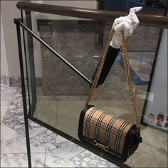 Articulated Arm Hands Out Burberry Purses Retail Fixtures, Store Fixtures, Short Hills Mall, Neiman Marcus Store, Purse Display, Burberry Purse, Visual Merchandising, Streetwear, Arms