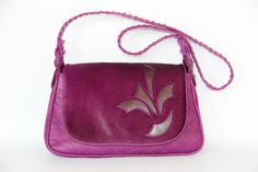 Fucshia quilted leather with pony hair cut out flap! Adds the perfect pop of color to your fall outfit.