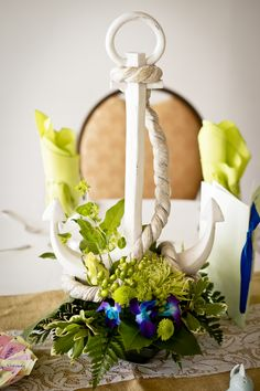 Beautiful Nautical Themed Centerpiece  Event Planner: http://www.eventsbyspecialmoments.com/  Photographer: http://ashfallmixedmedia.com/  See More: http://prettypearbride.com/2012/08/09/real-wedding-drop-anchor-at-this-seaside-wedding/#