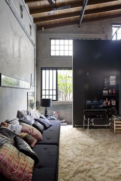 This would make a lovely student lounge like this with Pallets but with painted cement floors