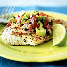 Grilled Mahi Mahi With Avocado-Chile Salsa Enjoy these top-rated grilled fish recipes outdoors this summer. Recipes include gingered honey salmon, tilapia piccata and even grilled fish tacos. Fish Dishes, Seafood Dishes, Seafood Recipes, Paleo Recipes, Cooking Recipes, Dinner Recipes, Cooking Tips, Main Dishes, Grilled Seafood