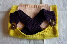 Knitted Childrens Apron size 2 yrs Yellow/Abricot/Purple with coconut-button 100% cotton. €27.50, via Etsy.