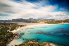 View of a beautiful bay with azure sea from top of a hill, Villasimius, Sardinia island, Italy, with a long exposure to move the clouds and to silk the sea - Fototapety popularne - Fototapety Honeymoon Cabin, Honeymoon Style, Sardinia Island, Sardinia Italy, Camping Holiday, Holiday Travel, Alghero, Travel Around The World, Around The Worlds