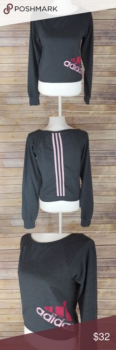 "Adidas crop sweater Dark gray cropped sweater with pink Adidas symbol and three pink, vertical lines on back. Sleeves are 25"", length is 17"", laying flat across is 17"". Like new condition. Says L but fits like a M. adidas Sweaters"