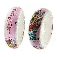 $15.00 - Ed Hardy Skull Art Bangle. This is an authentic Ed Hardy bangle. This photo shows both side of the bangle, your purchase includes ONLY 1 bangle. It includes certified of authenticity AND an Ed Hardy pouch. #PINKBangles #PINK #Bangle #PINKPixie #EdHardy #Nonprofit    All of our proceeds go to educating women in crisis. www.pinkpixie.org