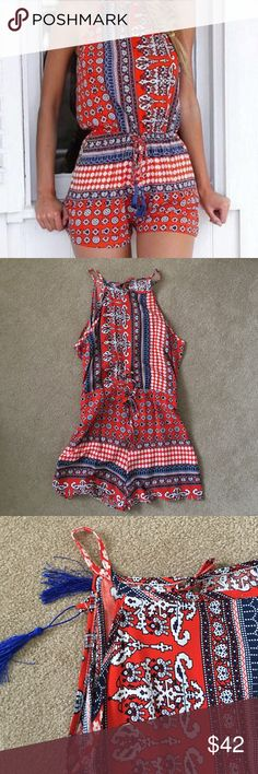Red and Blue Aztec Print Romper Red and Blue Aztec Print Romper with adjustable waist tie. Light and flowy material. Night neckline with an open slit down the back. GREAT condition. Pants Jumpsuits & Rompers