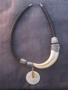 "https://flic.kr/p/orhWB7 | Mythmaker |  A bit of warthog tusk and shell shard and myths are born. Sterling silver, warthog tusk, African record heishi, shell shard. <a href=""http://www.e-bu-jewelry.com"" rel=""nofollow"">www.e-bu-jewelry.com</a>"