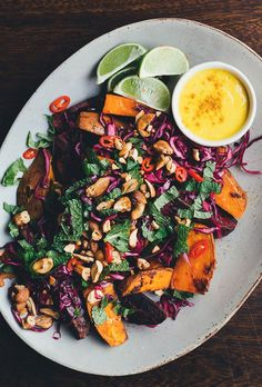 Spicy Thai sweet potato wedges that are loaded with all sorts of colourful toppings and served with creamy mango-turmeric sauce.