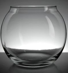 Equally lovely as a centerpiece vase or as a candle holder, our clear glass bubble ball vase measures tall with a openin.