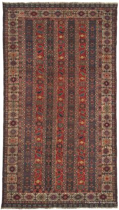 QASHQAI, Southwest Persian, 5ft 3in x 9ft 4in, Circa 1850. This superbly preserved mid-19th century long rug is a superb example of the antique rugs of the Kashkuli sub-tribe of the once-powerful Qashqai nomads of Southwest Persia. Its unusual column pattern requires tremendous precision to execute successfully, especially without the aid of a cartoon (a knot-by-knot schema.)