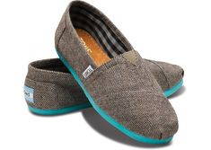 Toms slip ons with a teal sole.
