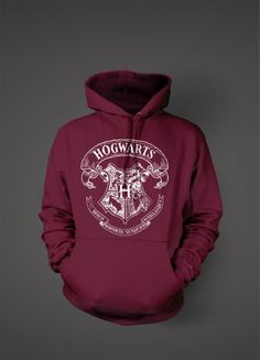 "20 of the Best Harry Potter Shirts and Merchandise the Internet Has to Offer. The Hogwarts crest is iconic. The school motto, which appears on the crest, is ""Draco dormiens nunquam titillandus,"" which means ""Never tickle a sleeping dragon. Harry Potter Shirts, Pull Harry Potter, Estilo Harry Potter, Harry Potter Outfits, Harry Potter World, Harry Potter Hogwarts, Hogwarts Crest, Slytherin, Harry Potter Sweater"