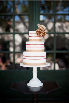 I photoshopped this beautiful cake i found to have red ribbon instead of just rose gold. I think it looks great!