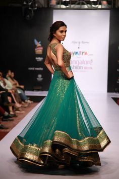 Turquoise #net #lehengacholi with golden border and blouse
