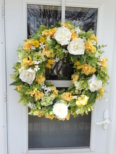 """White Peony & Yellow Hydrangea Wreath  This cheery bright wreath features clusters of white peony blossoms surrounded by yellow and bright green hydrangea blooms, vibrant yellow daisies and mini white flower blossoms, mixed with realistic looking eucalyptus, myrtle and a variety of lush spring greens.  Wreath Measures 27""""   Wreaths can be used indoor or outdoor in protected area.   Each wreath is created using a straw base, which offers an  extremely sturdy support. The back is covered in…"""