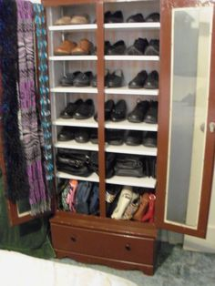 Added shelves to an old gun cabinet for shoes and purses.