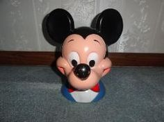 Vintage Mickey Mouse plastic piggy bank is in Great Condition. Comes with the original bottom plug. Marked on the back bottom, Walt Disney  Productions 1971. $60.00    Measurement: 10in. tall by 10 1/2in. wide.