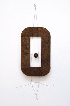 Mari Andrews. Rusty, 2011             found metal, wire, pod             17 x 8 x 1""
