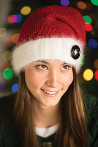 Kristy Kringle Hat - from Love of Knitting's Holiday Knits 2014 Issue  Add an extra bit of Christmas cheer to your next holiday party or family gathering with this jolly Santa hat! The luxurious angora gives the trim a beautifully soft halo, accented by a fun button of your choice.