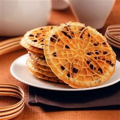 Hazelnut Chocolate Chip Pizzelle Recipe -I've experimented with different varieties of pizzelle recipes, but this is definitely a favorite. My dad likes to help make them so that we don't run out! Chocolate Chip Pizzelle Recipe, Pizzelle Cookies, Cookies Et Biscuits, Pizzelle Maker, Cookie Desserts, Just Desserts, Cookie Recipes, Dessert Recipes, Italian Cookies