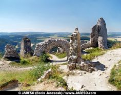 View from inside of ruined interior of the Castle of Cachtice in summer. This castle is situated in mountains above Cachtice village, region of Trencin, Slovakia. The Castle of Cachtice was residence and later the prison of the world famous Countess Elizabeth Bathory. Ruins of this famous castle were also featured in many movies. This castle ruin is declared as National Cultural Heritage of Slovakia.