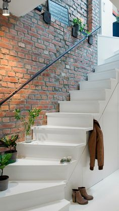polished white stairs and red brick wall