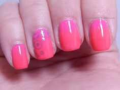 Gears stamped over hot pink to neon orange gradient manicure.